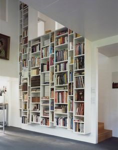 the best looking shelving is almost invariably white and wall-to-wall. A dark shelf against a white wall looks kind of stuck-on and cluttered.