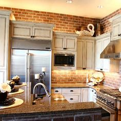 Kitchen traditional, exposed brick, rustic cabinets, stainless steel appliances