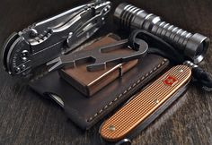 EDC kit I really need 10 of these,probably shows I need to down size a lot! two-inch pry bar that the U. Military found handy in one EDC kit, what girl couldn't use that. Everyday Carry Items, Edc Gadgets, Tac Gear, Edc Tools, Mens Gear, Cool Gear, Swiss Army, Tactical Gear, Survival Gear