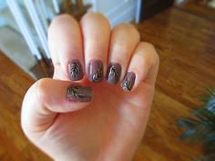 Purple black and gold feather nail art design