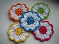 Springtime Coasters (FREE pattern)  I think these could be cute made smaller for baby headbands or connected together for an afghan.