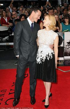 Swooning: Luke Evans held on tightly to his leading lady Sarah Gadon who plays his bride M...