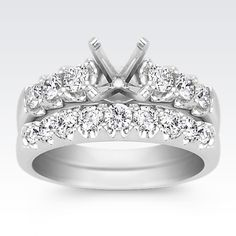 This brilliant wedding set features 15 round diamonds at approximately 1.03 carat total weight. Each diamond has been hand-matched for exceptional beauty and sparkle. These magnificent gems are set in a classic superior quality 14 karat white gold setting. To complete the look, add the center diamond of your choice.