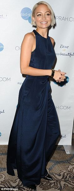 Contrasting style: Nicole, who had only weeks earlier been seen sporting a more natural mo...
