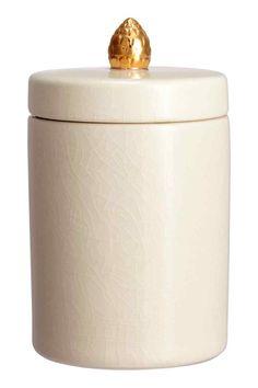 Cofanetto in gres: Cofanetto in gres con superficie craquelé. Tappo coordinato con pomello dorato. Altezza 14 cm, diametro 10 cm.