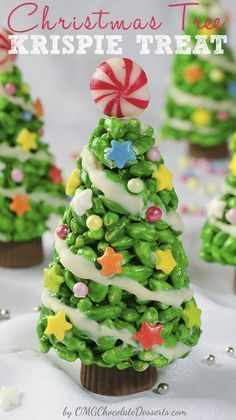 Christmas Tree Rice Krispie Treats. I love the peppermint candy tree topper and the peanut butter cup trunk!