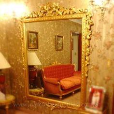Marco de espejo tallado y dorado a la hoja