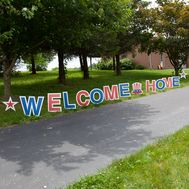 Eye-catching patriotic-themed yard sign for welcoming returning soldiers UV-printed sign is made with fade-resistant inks letters can be staked into the ground or held up by a group of friends Corrugated plastic material is durable and waterproof Custom Yard Signs, Lawn Sign, Corrugated Plastic, Plastic Material, Welcome Home, Soldiers, Printing, Letters, Eye