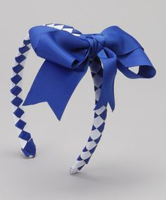 A big bow caps off this topper, keeping stylish little locks comfortably in place. Thanks to an alligator clip, each piece can be worn separately or together, depending on the mini fashion maven's mood.