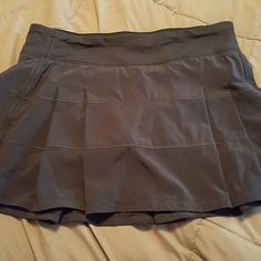 Lululemon Skort Lululemon pace rival skort. Size 8 tall purchased from another posher but too big. lululemon athletica Shorts