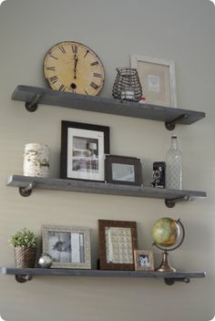 Reclaimed Wood and Metal Wall Shelves, perhaps different lengths and staggered on the back wall above the condiment station. Use some simple white ceramic and silver metal accessories to tie in the functionality of the condiment station with some pretty artifacts.