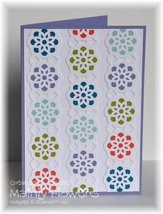 Create a beautiful geometric design using the lace ribbon border and circle punches.