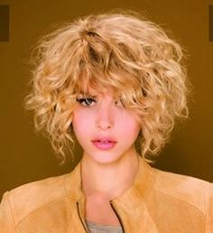 Short Layered Asymmetric Platinum Blonde Curly-Blonde-Hairsty