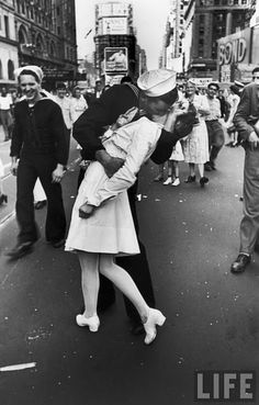 The most well known kiss in all history. Photographed by Alfred Eisenstadt. I personally like the guy on the left.