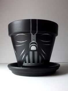New and improved Darth Vader Star Wars Painted Flower Pot Gift Set with Tray - another great one for geek dads! Might have to use this as inspiration for doctor who planter pots. next time i go to paint ceramics! Flower Pot Crafts, Clay Pot Crafts, Painted Flower Pots, Painted Pots, Hand Painted, Anniversaire Star Wars, Star Wars Crafts, Vader Star Wars, Darth Vader