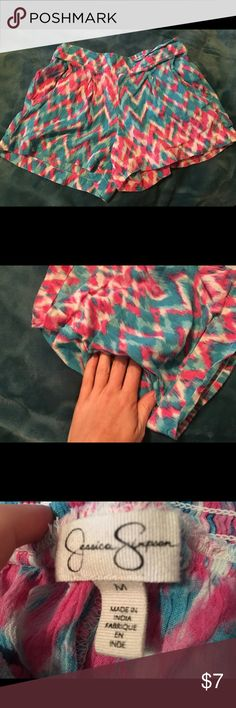 Jessica Simpson shorts Adorable multi colored chevron pattern Jessica Simpson flowy shorts. Size M (fit like a S). Elastic back waistband. Has pockets!! Colors are pink, blue and white. EUC, no damage at all. Perfect for lounging, errands, bedtime or girls coffee date. Super cute! #shorts #jessicasimpson #medium #small #chevron #cute ❌no trades❌ Jessica Simpson Shorts