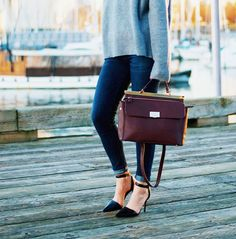 Loose knit sweater worn with skinny jeans, ankle strap pointy-toe heels, and a burgundy stachel via theaugustdiaries
