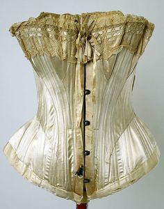 "Silk and cotton wedding lingerie, American, c. 1880. Satin corset with lace trim. Label: [stamped] ""Mme Pollan, 12 rue de Lafayette 12 Paris"""