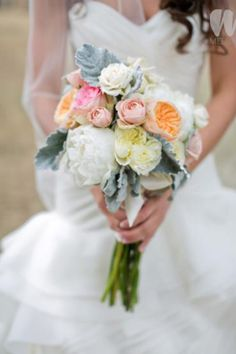 I really like the light pin and peachy flowers mixed with the white and blue/green leaves