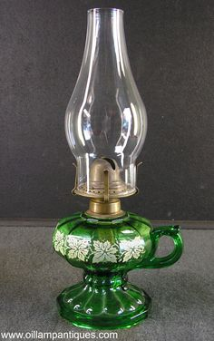 Emerald green glass pedestal finger oil lamp with stencil decorated font circa 1920