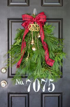 a beautiful, festive, and easy holiday door swag using what you have around the home and a few additional embellishments. its christmas Christmas Front Doors, Christmas Door Decorations, Christmas Swags, Christmas Ribbon, Christmas Holidays, Christmas Ideas, Xmas, Christmas Snowman, Holiday Ideas