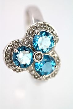 Previously Owned 10k White Gold Diamond & Blue Topaz Ring size 6.5