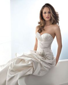 Taffeta fit and flare wedding dress with asymmetrical pleating ...