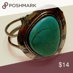 Large turquoise bracelet Nwot This is one gorgeous southwestern vintage style bracelet! Set in a Silvertone swirled etched cuff is a large turquoise Medallion! *Hinged bracelet Jewelry Bracelets