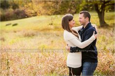 Beautiful engagement photo in an open field. Love the embrace. #engagement #photoshoot #photography #fall