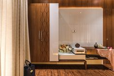 A stylish and urban apartment designed by the leading designers Mrs Misha Shah and Mr Sumit Apartment Entrance, Urban Apartment, Apartment Design, Tv Unit Bedroom, Bedroom Tv Wall, Bedroom Tv Unit Design, Bedroom Designs, Tv Unit Interior Design, Room Interior