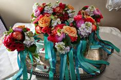 coral and turquoise bride and bridesmaids' bouquets for a ranch wedding