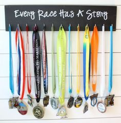 "RUNNING MEDAL DISPLAY ""EVERY RACE HAS A STORY"" Black w/White Lettering"