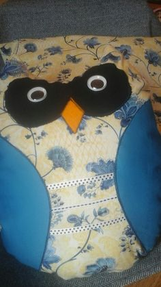 Yellow background with blue floral print 12 inch tall decorative owl cushion.
