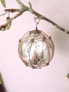 This exquisite Christmas decoration is made from silver mercury glass and is wrapped in wire. It would be perfect to hang from a Christmas tree but also makes a great table decoration when clustered with other baubles in a bowl. www.heavenlyhomesandgardens.co.uk