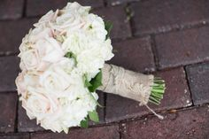 Bride's bouquet wrapped in burlap and jute.