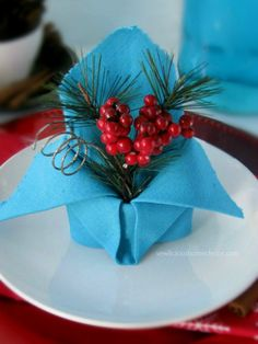 In this Holiday Crown fold, the napkin works as a pretty display for photos, name tags or greenery.