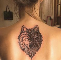 mandala wolf back tattoo