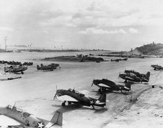 Marine Corps TBF-1 Avengers at the Munda Airstrip, New Georgia, Solomons, mid-1943. Note that only one aircraft has the white bars added to the National Insignia.