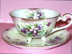 ROYAL SEALY 3 FOOTED Tea Cup and Saucer PURPLE VIOLETS Floral Teacup Japan - CAD $45.25. VERY GOOD CONDITION..No Chips, No Cracks, No Crazing. READ DESCRIPTION! ROYAL SEALY 3 FOOTED Tea Cup and Saucer PURPLE VIOLETS Floral Teacup Japan Click images to enlarge Description ROYAL SEALY 3 FOOTED PURPLE VIOLETS TEA CUP AND SAUCER Made in Japan...Dating c.1940s This stunning vintage set features striking purple violets with pink and gold background. The cup sits on 3 tiny feet, with fancy handle…