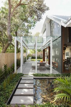 chic sydney house extends its living area with a cool glass roofed pergola metal pergola. Black Bedroom Furniture Sets. Home Design Ideas