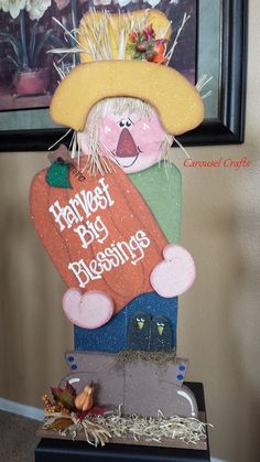 Cute wood Scarecrow Fall craft by Carousel Crafts.