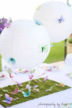 Tape tiny butterflies to Chinese lanterns and clip to the party table.