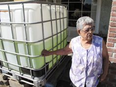 EAST PORTERVILLE, Calif. (AP) — Hundreds of domestic wells in California's drought-parched Central Valley farming region have run dry,  Monday, Sept. 15, 2014, Vickie Yorba, 94, stands next to a water tank in front of her home in East Porterville, Calif., where she has lived for 66 years. Hers is one of 290 East Porterville wells that ran dry in the state's historic drought. Since February, she has had to rely on friends, relatives and charities for water to drink and bathe.