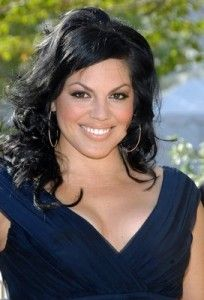 sara ramirez...like this hair style and the top of that dress