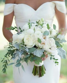 Take a look at 14 amazing white wedding bouquet photos you will love in the photos below and get ideas for your wedding! Flower Muse Our Favorite: White Flowers for a beautiful wedding bouquet Image source Summer Wedding Bouquets, Bride Bouquets, Floral Wedding, Wedding Dresses, Simple Bridesmaid Bouquets, Bridal Bouquet White, Wedding Summer, Greenery Bouquets, Cascading Bridal Bouquets