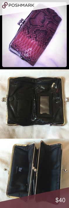 """Bought at The Buckle wallet. Snakeskin Buckle. Fashion Express snakeskin wallet. 8"""" x5"""" x about 2"""" (when being used :) Buckle Bags Clutches & Wristlets"""