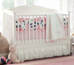 Not to give you an excuse to change your mind, but here is the pink/navy nursery you were talking about for a while... (Mallory Bedding/ PBK)