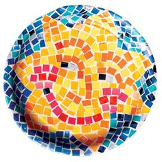 mosaic made with squares cut from magazine pages and glued to the back of a paper plate