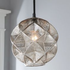 This mercury glass geodesic dome pendant light has prismatic reflections that create an artistic aura. Perfect for dressing up rustic, eclectic, and boho luxe looks, this striking little pendant brings texture and sparkle that accents other, simpler mercury glass fixtures, antique mirrors, and subtly distressed decor.