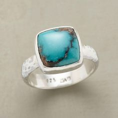 TURQUOISE SQUARED RING -- In this handcrafted turquoise squared ring, gently rounded corners soften a square of turquoise perched on its lightly hammered setting of sterling silver. Handcrafted. Stone color and matrix will vary. Exclusive in whole and half sizes 5 to 9.